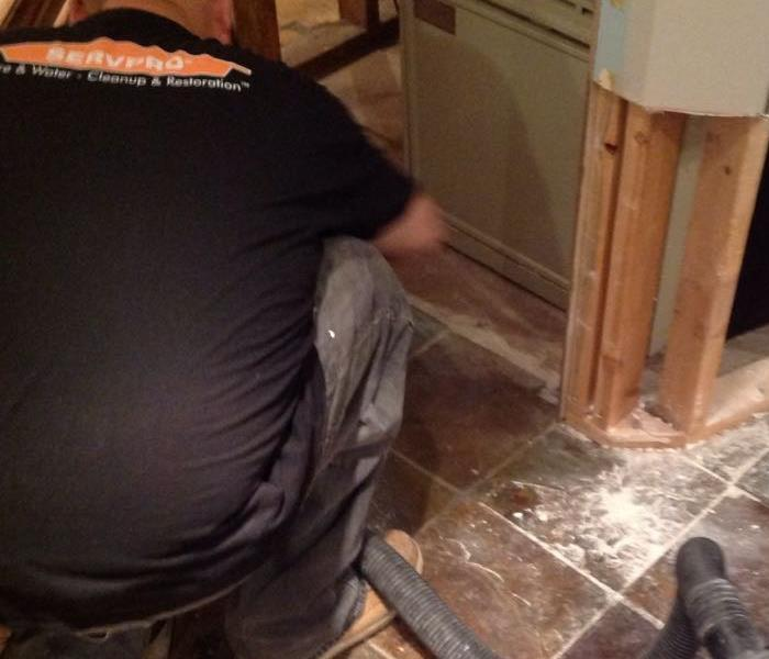 SERVPRO team member in action creating flood cuts in wall.