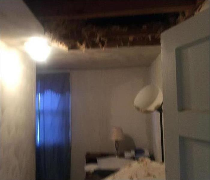 Big hole on ceiling due to storm damage