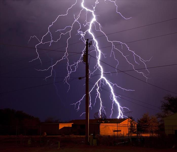 lightning bolt behind electric utility pole